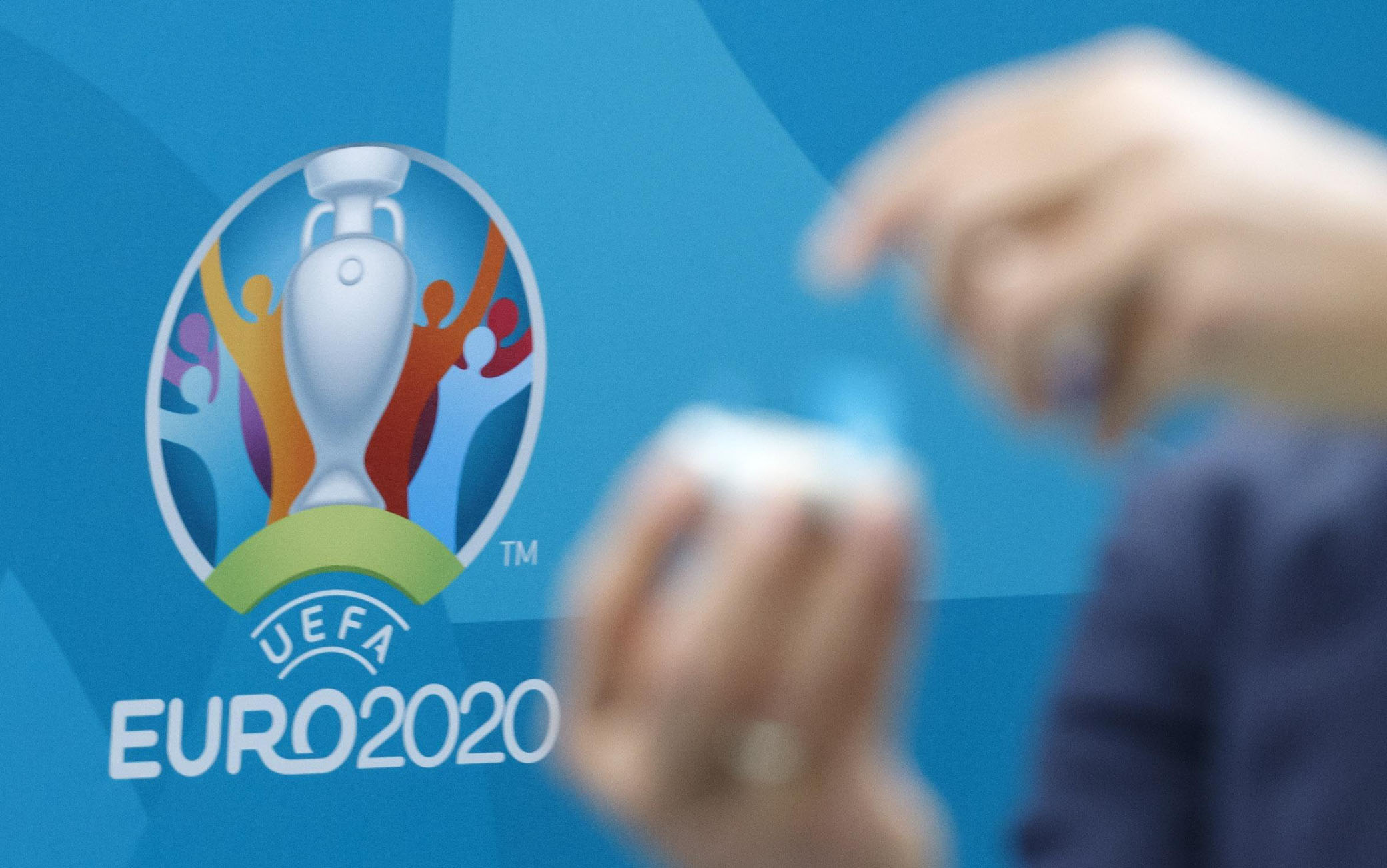 epa08016923 Former Greek soccer player Angelos Charisteas opens a ball containing the name of a national soccer team during  the drawing of the UEFA EURO 2020 Play-off matches, at the UEFA headquarters in Nyon, Switzerland, 22 November 2019.  EPA/SALVATORE DI NOLFI